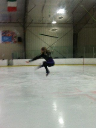 Abagail Smentkowski lands a jump while in the harness at a recent practice at the Clifton Park Ice Arena. Submitted photo.