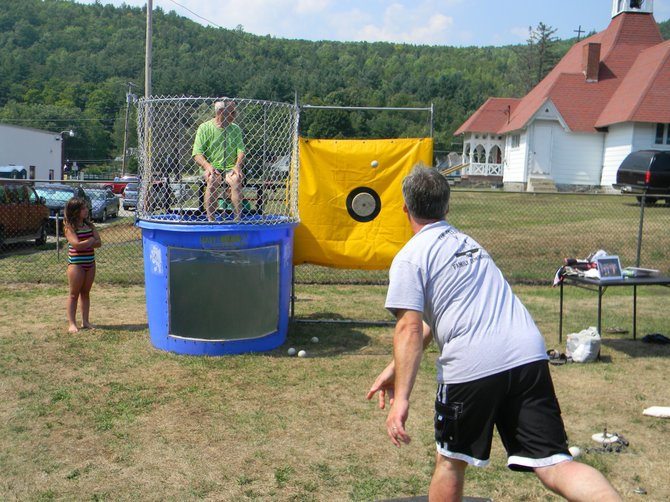 REFRESHING PLUNGE AHEAD: During Horicon Day festivities on Saturday Aug. 4, Horicon Town Councilman and event chairman Matt Simpson takes a shot at fellow councilman Bob Olson, the event's 2011 chairman.