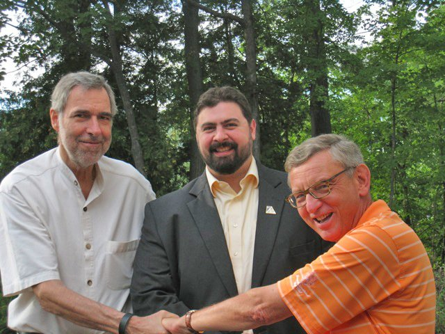 The Ticonderoga Revitalization Alliance no longer has a chief operating officer. J. Justin Woods, who took the job last September, has left because of a funding shortfall.  From left are Alex Levitch, alliance founder, Woods and Sanford Morehouse, alliance board member.