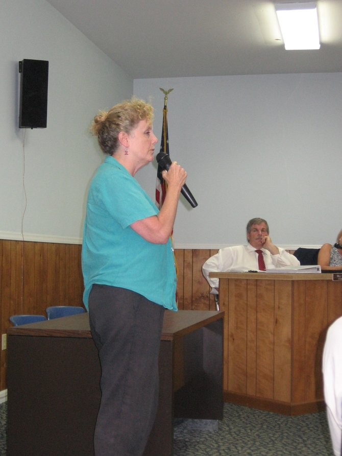 Ballston resident Terri Robben spoke out against the town's proposed legislation concerning residential solar installations. Board member Bill Goslin, seated in the background, listened intently to a number of residents as they voiced their opinions about a possible moratorium on freestanding installations.