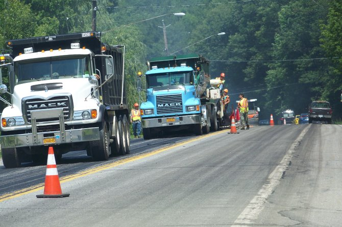 Employees of a DOT contractor work recently on a paving project on state Rte. 9 between Lake George and Warrensburg. As of Aug. 3, a new asphalt surface was applied northward to a point just south of the Warrensburg town line. Work on re-paving Rte. 9  through Warrensburg is expected to begin in the coming weeks, and town officials are hoping the work doesn't conflict with the World's Largest Garage Sale event, set for the end of September.