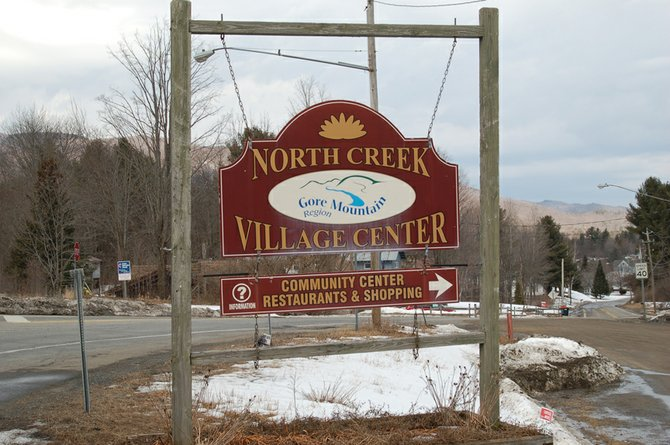 Sign welcoming motorists to North Creek