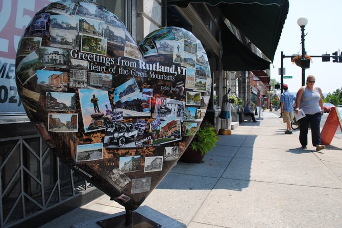 "This giant fiberglass ""heART"", plastered with colorful images of classic local postcards, is located near Tattersalls Clothing Emporium along Merchants Row."