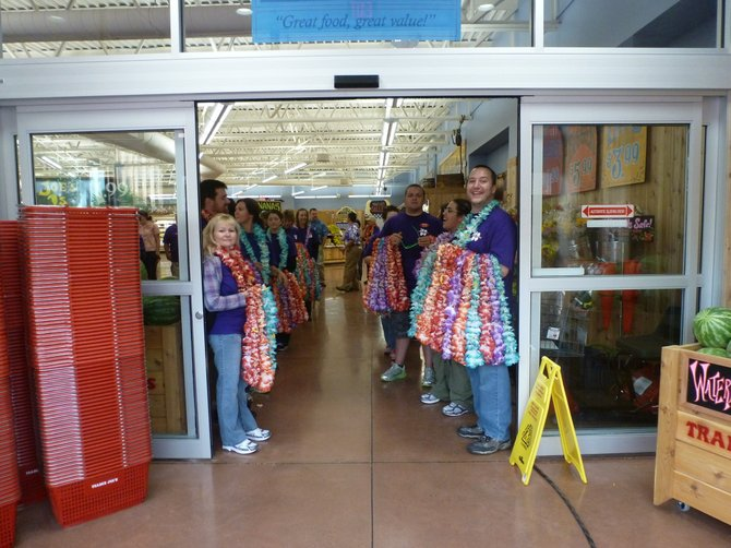 Trader Joe&#39;s employees line up to greet the first customers of the new location in Colonie on Friday, Aug. 3