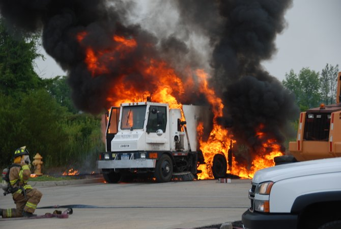 A vehicle on fire in the Glenmont Lowe&#39;s parking lot produced a thick column of black smoke that could be seen for miles.