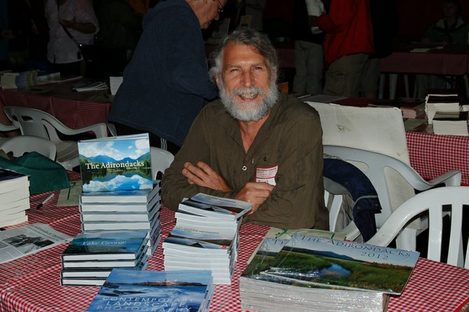 Photographer Carl Heilman sits at the 2011 Adirondack Authors' Night at Hoss's Country Corner in Long Lake. This year's event will be held 7-9 p.m. Tuesday, Aug. 14.