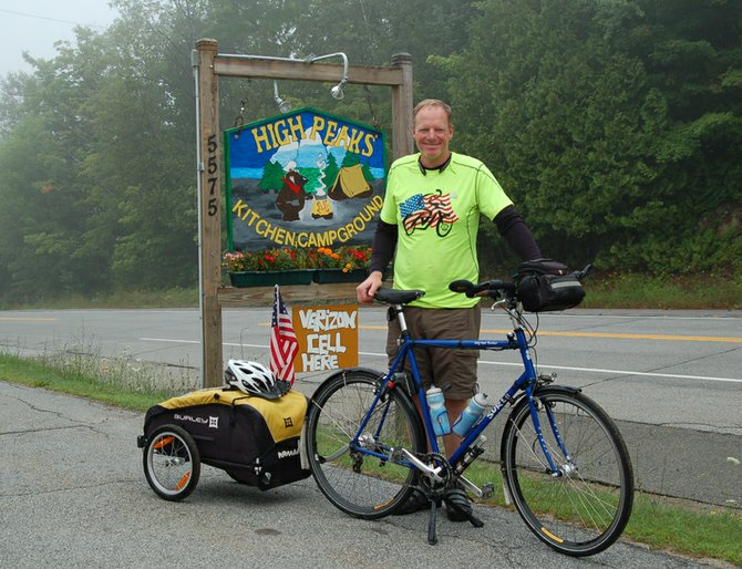 Mark Mansell gets ready to leave the High Peaks Campground in Newcomb on the morning of Thursday, Aug. 2 on his way to Ticonderoga.