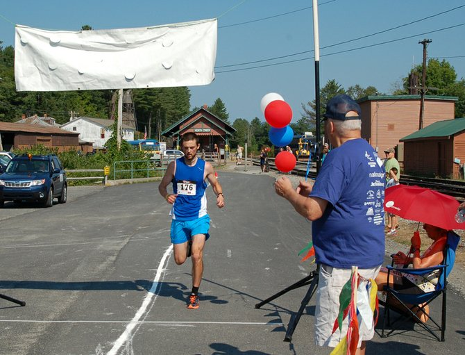 Paul Allison, of Jericho, Vt., was the first to cross the finish line Saturday, Aug. 4 at the Race the Train event in North Creek with a time of 46:59.