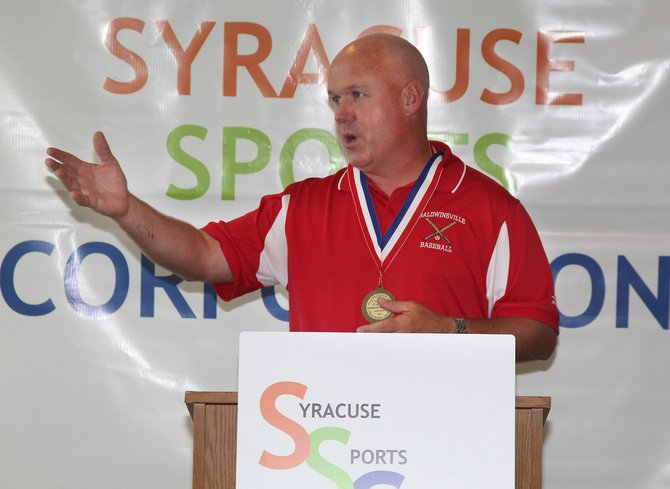 Baldwinsville varsity baseball Dave Penafeather speaks at the 'Believe to Achieve' awards event last Thursday at Alliance Bank Stadium. Penafeather was given the Coaches Award from the Syracuse Sports Corporation after leading the Bees to the state Class AA semifinals last June.