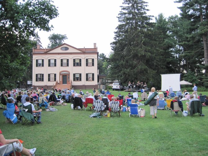 "Attendees of the 2011 ""Moonlight Medley,"" find their choice spots on the lawn of the Lorenzo State Historic Site. This year, ""Breakfast at Tiffany's"" will be shown at 8 p.m. Aug. 16, following the JT Hall Consort's musical offering, which begins at 6:30 p.m."