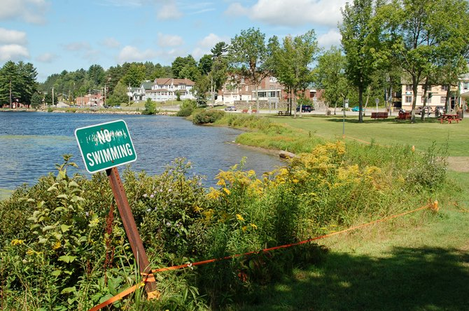 A no swimming sign is posted at the park on Lake Flower in Saranac Lake where the original municipal beach was located until the mid-1970s.