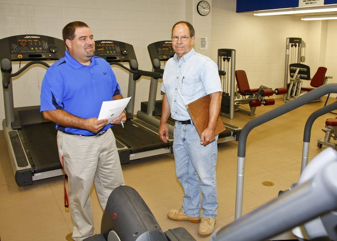 Bill Larrow, left, Moriah Central School superintendent, and Calvin Nephew, clerk of the works, look over the school's new fitness room. The room is part of a recently-completed $9.9 million building project.