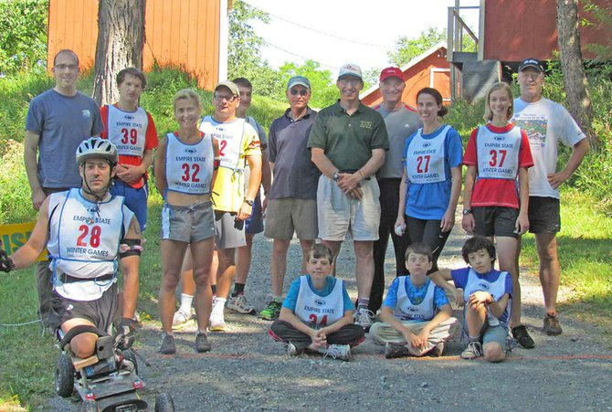 Participants pose during one of the Capital Region Nordic Alliances biathlon events this summer.