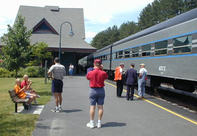 Tourists enjoy the Adirondack Scenic Railroad at the Union Depot in Saranac Lake. 