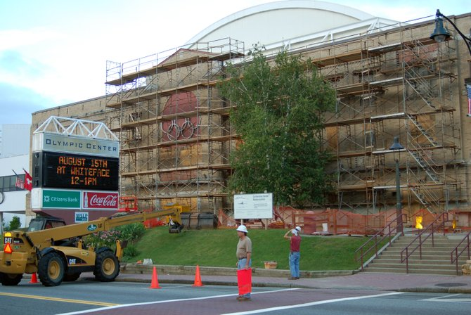 Crews work on revitalizing the 1932 Olympic Arena facade in Lake Placid.