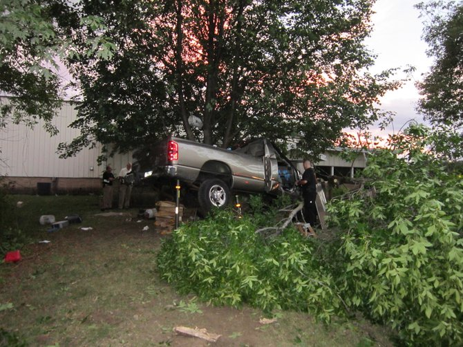 A pickup truck crashed into trees off Fly Road in the town of DeWitt last night, claiming the lives of both the driver and passenger.