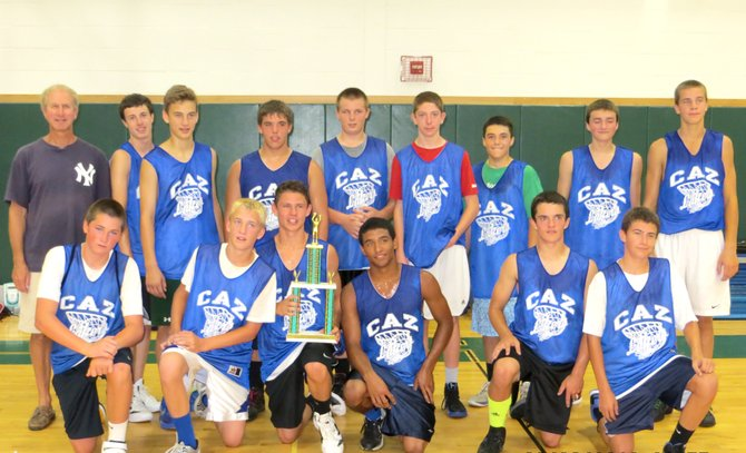Members of the Cazenovia High School Junior Varsity Basketball program celebrate with their trophy after winning the Onondaga Central School Junior Varsity Boys Summer League Championship. In the front row sits Ryan Henderson, left, Keaton Ackerman, Peter Burr, Devlin White, Alex Devine and Noah Race. In the back row, JV Coach Tom Eschen, left, stands beside Sean Satchwell, Liam Johnson, Hayden Polhamus, Sean Cunningham, Noah Nash, Jake Wozniak, Brendan Fox and Ross Gerber. Absent from the photo are Kevin Ridings and Evan Cornell.