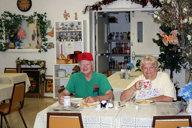 Ray and Edna Ryan, of Rotterdam, enjoying breakfast at the senior center on Wednesday, Aug. 15. The couple comes every Wednesday to have breakfast with cook Pina De Marco.