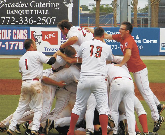 The Albany Athletics celebrate their first Stan Musial World Series championship Aug. 13 in Port St. Lucie, Fla.