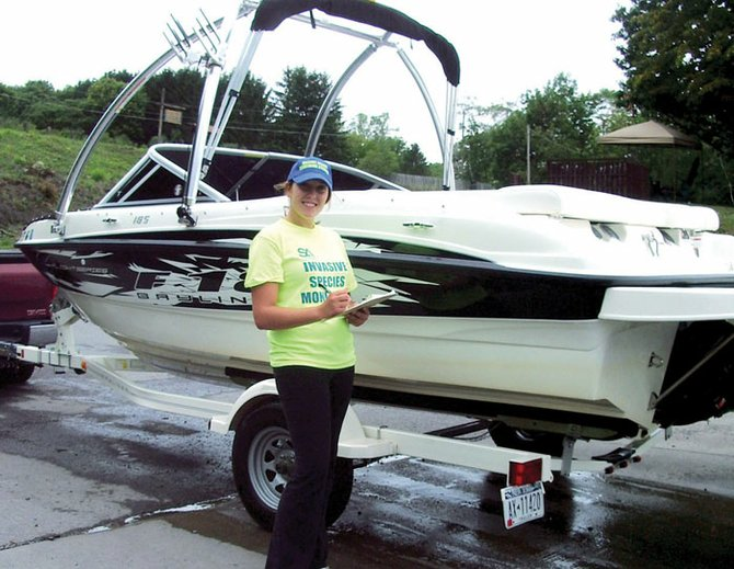 Rachael DeWitt, SLA Invasive Species Monitoring Steward, checks a boat for invasive hitchhikers before it is launched into Skaneateles Lake. The stewardship program was launched by the SLA this summer with cooperation from the Skaneateles Town Board. The David Lee Hardy memorial Fund will help the SLA pay for the program and other education efforts.
