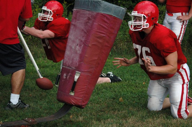 Saranac Lake players work on tackling dummy drills.