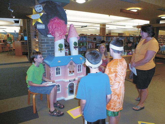 Participants in Bethlehem Public Library's life-size Candyland game got candy and sticker rewards as they moved along the game board. The event was part of the library's summer reading program.