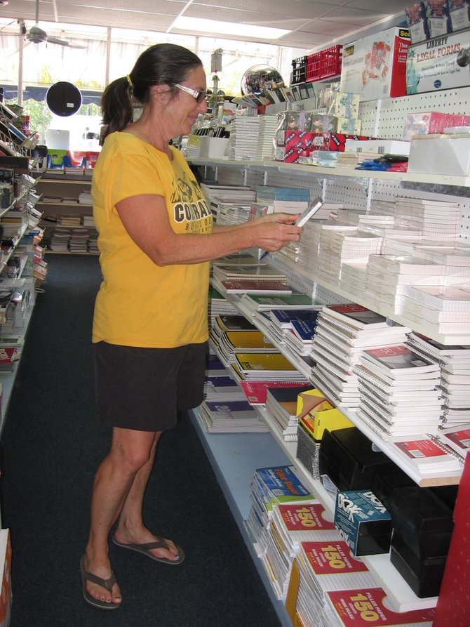Longtime customer Suzanne Voigt peruses the offerings at Mal 'N' More. She's been getting her printing needs and office goods from the store for 15 years.