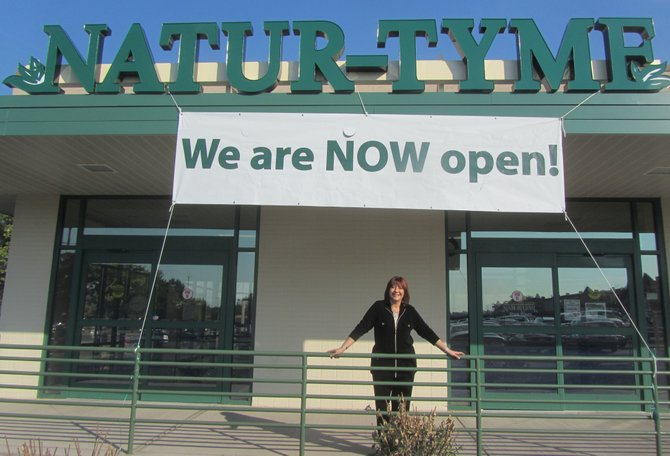 Wendy Meyerson, owner, poses in front of Natur-Tymes new location on Erie Boulevard in DeWitt.
