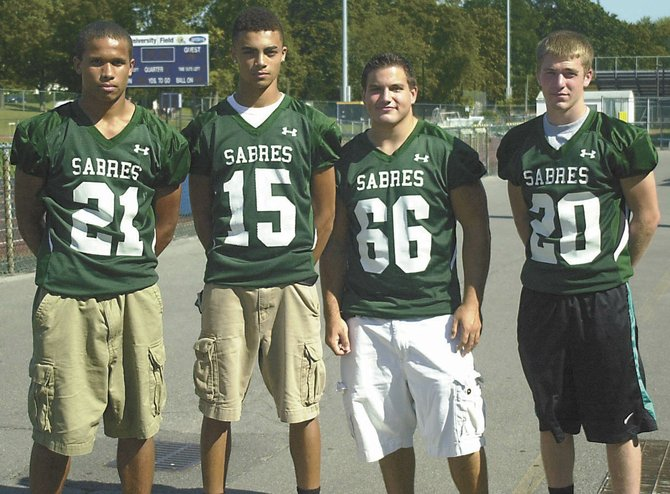 The three-time defending Section II Class B champion Schalmont Sabres graduated several starters from last year's team, but they have a core to build around including, from left, Devon Willis, Jesse Ross, Chas Higgins and Kyle Binkley. The Sabres begin their season Friday against Glens Falls in Rotterdam.