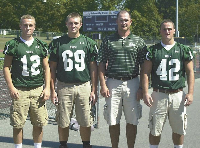 New Shenendehowa coach Brian Clawson, second from right, is looking to guide the Plainsmen to another Section II Class AA football title with the assistance of several returning players including, from left, quarterback Ryan Buss, lineman Christopher Stewart and running back Lucas Buckley. Shen begins its first season without longtime coach Brent Steuerwald Friday at Albany. 