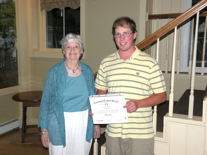 Erieville resident Brian Eberst, right, stands with his External Diploma Program Assessor Bunnie Hannum of OCM BOCES and displays his newly-acquired EDP high school diploma.