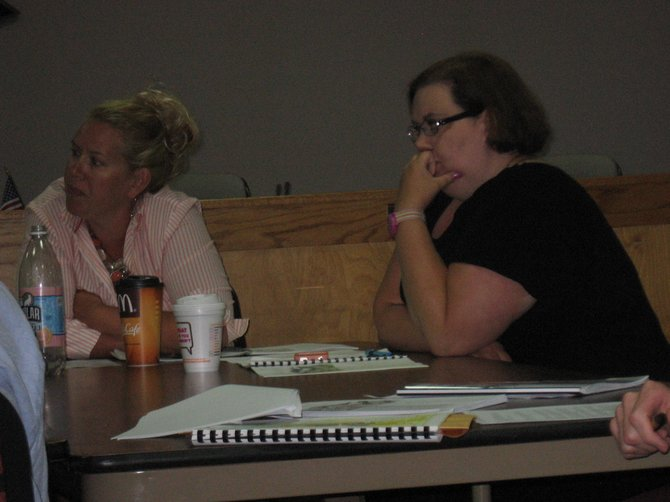 Town of Malta Councilwomen Tara Thomas, (background) and Maggi Ruisi listen as other members share their thoughts on some of the details of the drafted form-based code zoning. Town officials have been refining the zoning plan for several months.