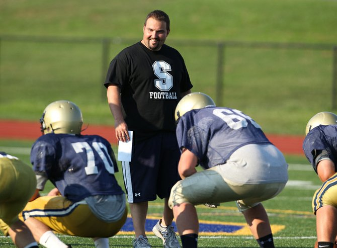 New varsity football head coach Joe Sindoni leads team practice last Thursday, Aug. 23, at the high school football field.