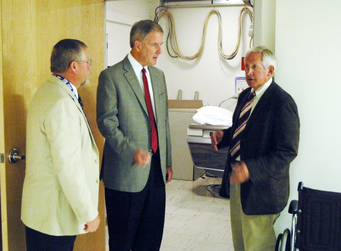 "Congressman Bill Owens of Plattsburgh, center, speaks with Elizabethtown Community Hospital CEO Rod Boula, left, and Jim Forcier, President of the ECH Board of Directors, left. Boula said that if the federal government allows the, ""sequester,"" to happen, cutting federal funding to programs like Medicare, hospitals like ECH would suffer."