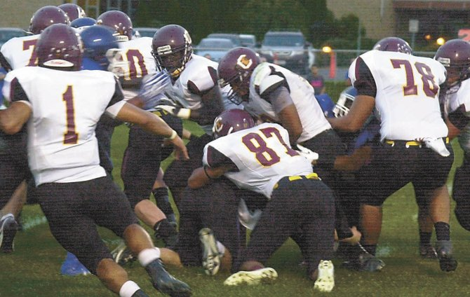 Colonie fullback Wayne Burt, center, travels through traffic near the goal line during the first quarter of Fridays Liberty Division game at LaSalle.