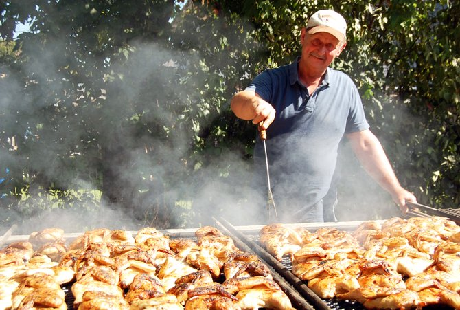 Jake Rafferty prepares hundreds of chicken breasts for the chicken BBQ at the Au Sable Forks Labor Day celebrations.