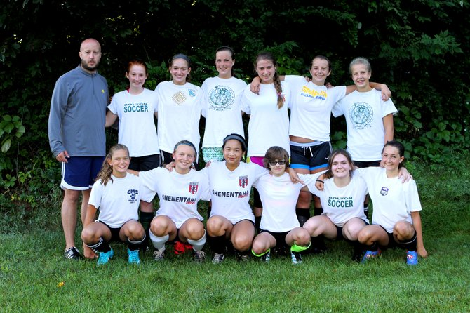 The 2012 Bolton Varsity Girls Soccer team includes (front, left to right): Abbie Seamans, Lindsay Markham, Kim Wright, Kenzie Tennent, Micaela Perrelli, Andi Pfau, (rear): Coach Patrick Morency, Molly Schodes, Olivia Seamans, Erin Courchaine, Maddy Wilson, Olivia Clesceri, and Caroline Clesceri. (Not pictured): Sarah Calzada, Ceshele Powell and Sydney LaPan.