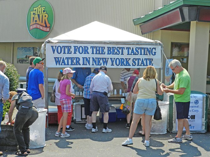 Attendees at the New York State Fair in Syracuse taste drinking water samples from 10 communities across the state. Niskayuna was crowned the best drinking water in the state at this year's contest, with Guilderland nabbing second place.