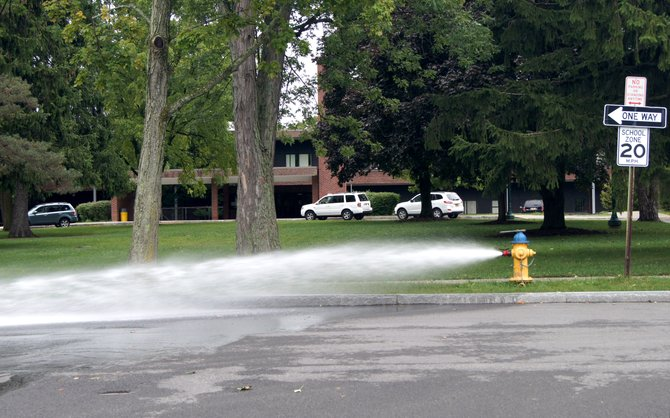 A hydrant outside of Cazenovia Middle School releases excess water on Sept. 5. Classes at the high school and middle school were cancelled Sept. 5 and 6 due to a water main break. Classes at Burton Street Elementary School were conducted as normal both days.