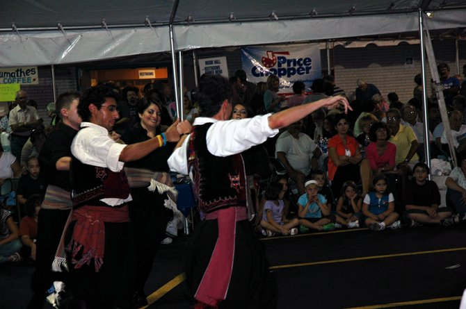 Dancers wearing traditional Greek costumes entertain people at last year's Greek Festival.