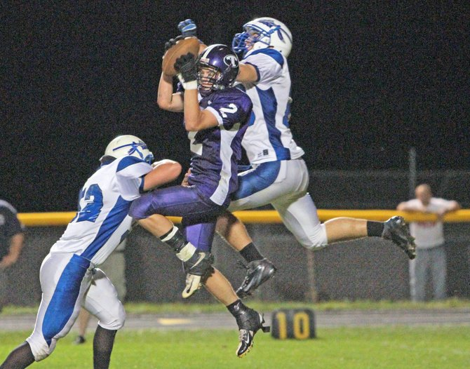 Ticonderoga's Jarryn Granger pulls down a reception between Peru defenders during the Sentinels' 35-7 loss in Champlain Valley Athletic Conference action Sept. 7. Granger had three catches for 42 yards in the game.