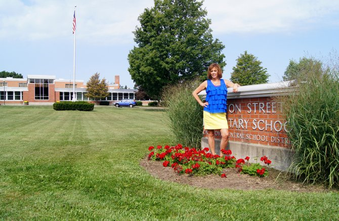 Burton Street Elementary School Principal Mary-Ann MacIntosh stands in front of the school in Cazenovia after hearing it was recognized as a 2012 National Blue Ribbon School on Sept. 7.