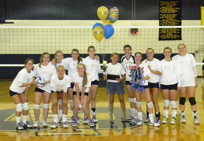 Coach Doreen Doctor and her volleyball team celebrate her 200th career victory after their win over Liverpool last week. Pictured in the photo left to right, Front: Mallory Davis, Casey VanSlyke, Sidney Lawson. Back: Mia Campanile, Amanda Shoenfelt, Kelsey Farrell, Anna Smith, Malorie Olin, Coach Doctor, Julianna Augustine, Natalie Roach, Kristina Didio