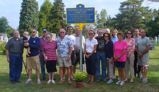Members of the Skaneateles Town Board and the Shepard Settlement Neighborhood Association, as well as local residents, turned out on Labor Day for the ceremony dedicating the new plaque designating Shepard Settlement Cemetery a national historic cemetery.