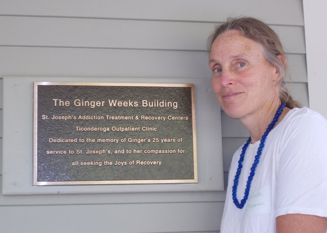 Malinda Chapman stands with a plaque in honor of her mother, Dr. Ginger Weeks, at the  St. Joseph's Addiction Treatment and Recovery Center out-patient clinic in Ticonderoga. The Ti clinic has been renovated and expanded.
