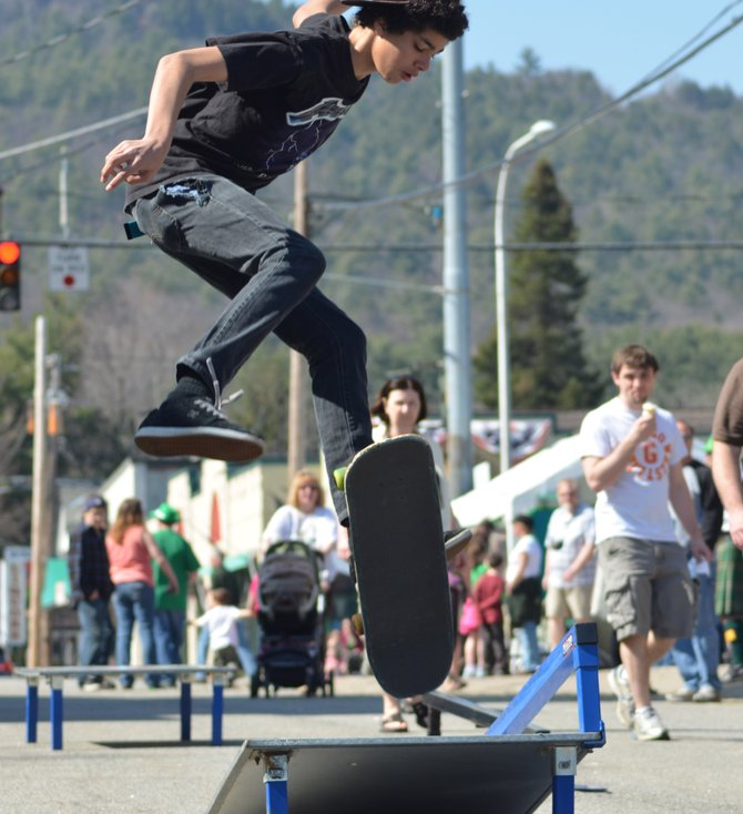 A local skateboarder flies off a ramp during a demonstration held in conjunction with the 'Sham Rock the Block' event held on St. Patrick's Day weekend in Lake George. More than a dozen teenagers have been working for years to establish a skate park where they can hone their skills. The day after this shot was taken, two local skateboarders practiced their sport behind the Village Mall using a weathered picnic table as a ramp — an action that sparked a court fight that ended up on the Judge Judy Show. The segment is to air at 4 p.m. Tuesday Sept. 11.