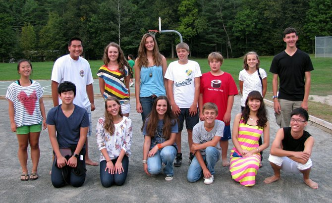 Six International students, pictured here with their host siblings, will be attending Keene Central School this year.