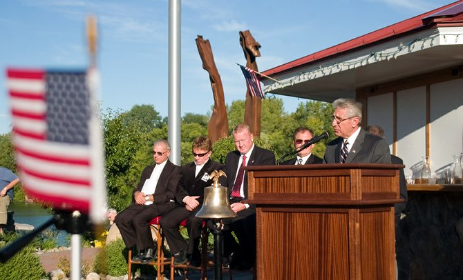 Assemblyman James Tedisco shares remarks during the sixth annual 9/11 ceremony at The Waters Edge Lighthouse in Glenville.