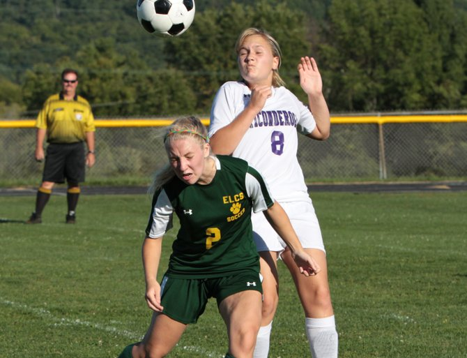 Kylee Cassavaugh, left, of Elizabethtown-Lewis and Ticonderoga's Maura Jebb use their heads in Northern Soccer League girls play Sept. 11. ELCS edged Ti, 2-1.