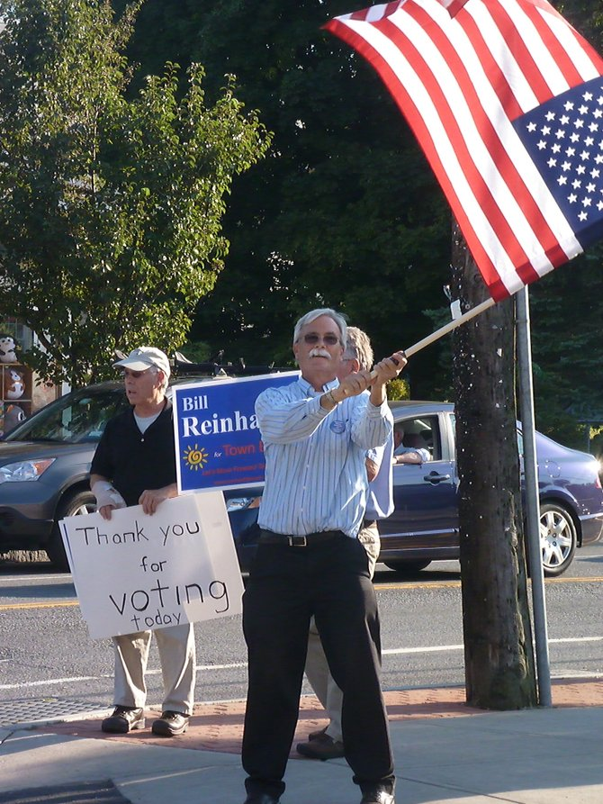 Bethlehem town Board Democratic primary candidate Bill Reinhardt stands at Delmar&#39;s four corners with his volunteers to thank residents for voting on primary day. 
